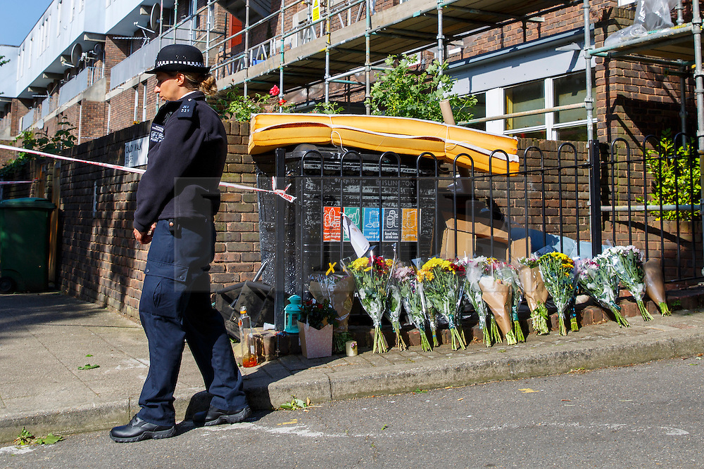 © Licensed to London News Pictures. 11/06/2015. London, UK. Police officers investigating a scene where a 17-year-old boy was stabbed to death in Caldy Walk, Islington, north London. Photo credit: Tolga Akmen/LNP
