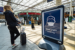 Edinburgh, Scotland, UK. 17 June, 2020. Views from Edinburgh city centre before expected relaxation of covid-19 lockdown by Scottish Government. Pictured; Sign asking passengers to wear face covering on concourse at Waverley Station. Iain Masterton/Alamy Live News