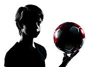 one caucasian young teenager silhouette boy girl holding showing soccer football portrait in studio cut out isolated on white background