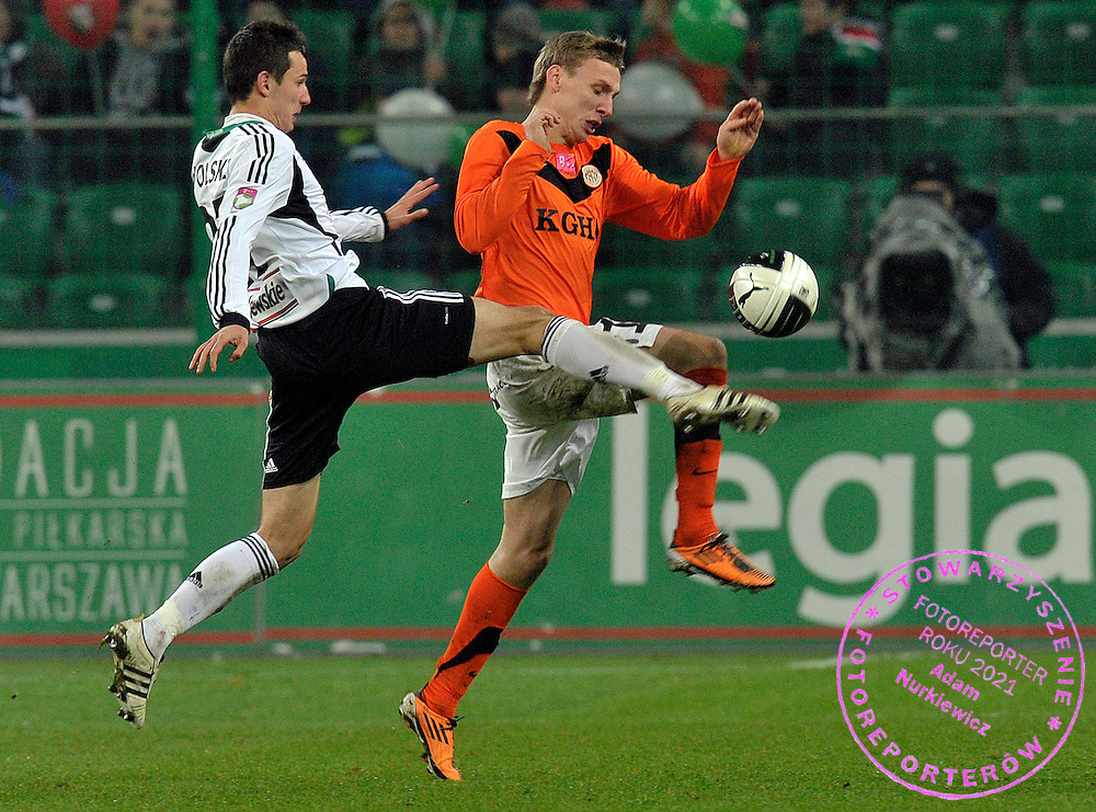 (L) Legia's Rafal Wolski fights for the ball with (R) Zaglebie's Arkadiusz Wozniak during T-Mobile Extraleague soccer match between Legia Warsaw and Zaglebie Lubin in Warsaw, Poland...Poland, Warsaw, November 23, 2011..Picture also available in RAW (NEF) or TIFF format on special request...For editorial use only. Any commercial or promotional use requires permission...Photo by © Adam Nurkiewicz / Mediasport