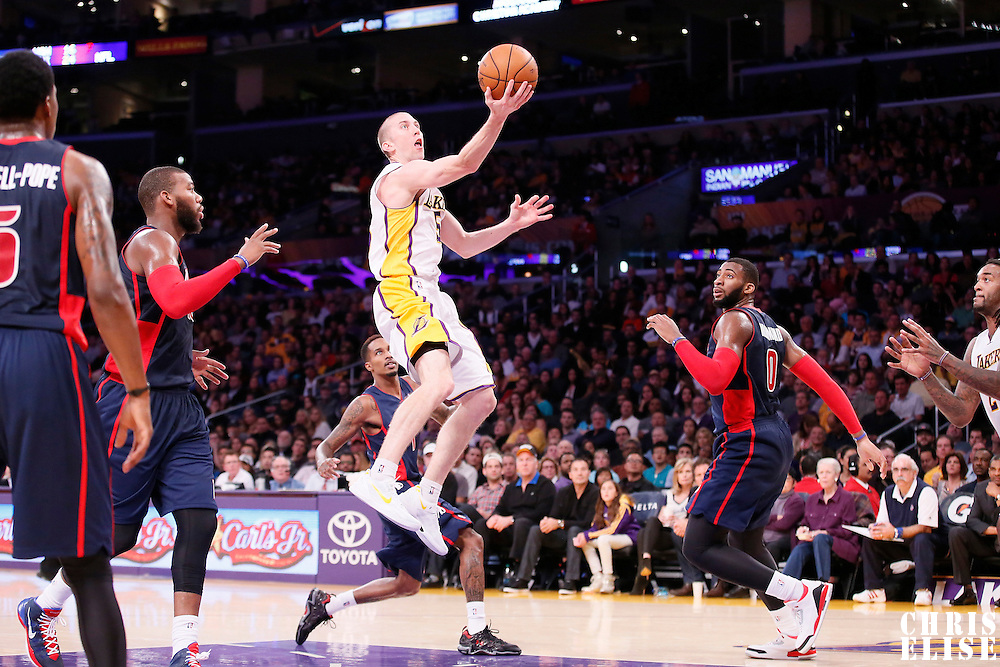 17 November 2013: Los Angeles Lakers point guard Steve Blake (5) goes for the layup during the Los Angeles Lakers 114-99 victory over the Detroit Pistons at the Staples Center, Los Angeles, California, USA.
