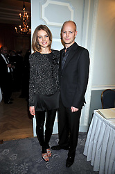 The HON.JUSTIN PORTMAN and NATALIA VODIANOVA at the 3rd Fortune Forum Summit held at The Dorchester Hotel, Park Lane, London on 3rd March 2009.