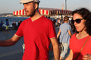 Young Turkish couple walking near the Eminonu quayside, Istanbul, Marmara, Turkey. Eminonu is on the South bank of the Golden Horn at the Southern end of the Galata bridge. Picture by Manuel Cohen