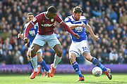 Birmingham City striker Lukas Jutkiewicz (10) controls under pressure from Aston Villa defender (on loan from Wolverhampton Wanderers) Kortney Hause (30) during the EFL Sky Bet Championship match between Birmingham City and Aston Villa at St Andrews, Birmingham, England on 10 March 2019.