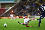Marcel Ritzmaier of Barnsley FC is brought down by Danny Simpson of Huddersfield Town during the EFL Sky Bet Championship match between Barnsley and Huddersfield Town at Oakwell, Barnsley, England on 11 January 2020.