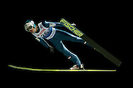 Michael Hayboeck of Austria competes during FIS World Cup Ski Jumping competition in Wisla, Poland on January 16, 2014.<br /> <br /> Poland, Wisla, January 16, 2014.<br /> <br /> Picture also available in RAW (NEF) or TIFF format on special request.<br /> <br /> For editorial use only. Any commercial or promotional use requires permission.<br /> <br /> Mandatory credit:<br /> Photo by © Adam Nurkiewicz / Mediasport