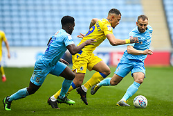 Jonson Clarke-Harris of Bristol Rovers takes on Liam Kelly and Brandon Mason of Coventry City - Mandatory by-line: Robbie Stephenson/JMP - 07/04/2019 - FOOTBALL - Ricoh Arena - Coventry, England - Coventry City v Bristol Rovers - Sky Bet League One