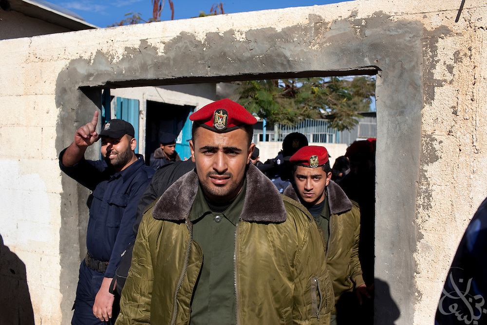 HAMAS border police leave basic training December 21, 2009 at the City of Arafat Police headquarters in Gaza City, Gaza following an overhead flight by an Israeli fighter jet. The HAMAS police force was one of the main targets of the 22 day Israeli offensive a year ago and lost more than 150 members on the first day of strikes alone. The past year has seen HAMAS slowly rebuild its capacity, although the organization is careful not to congregate in large groups and only trains now in small numbers to avoid being an easy target again. Daily across the strip, HAMAS evacuates its offices if it hears or sees any Israeli aircraft in the skies above.