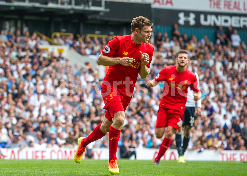 James Milner of Liverpool celebrates scoring the opening goal during the Premier League match between Tottenham Hotspur and Liverpool at White Hart Lane, London, England on 27 August 2016. Photo by Vince  Mignott.