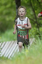 """(Kingston, Ontario---16/05/09) """"Ethan Sparks running in the kids race at the 2009 Salomon 5 Peaks Trail Running series Race held in Kingston, Ontario as part of the Eastern Ontario/Quebec division. """"  Copyright photograph Sean Burges / Mundo Sport Images, 2009. www.mundosportimages.com / www.msievents.com."""