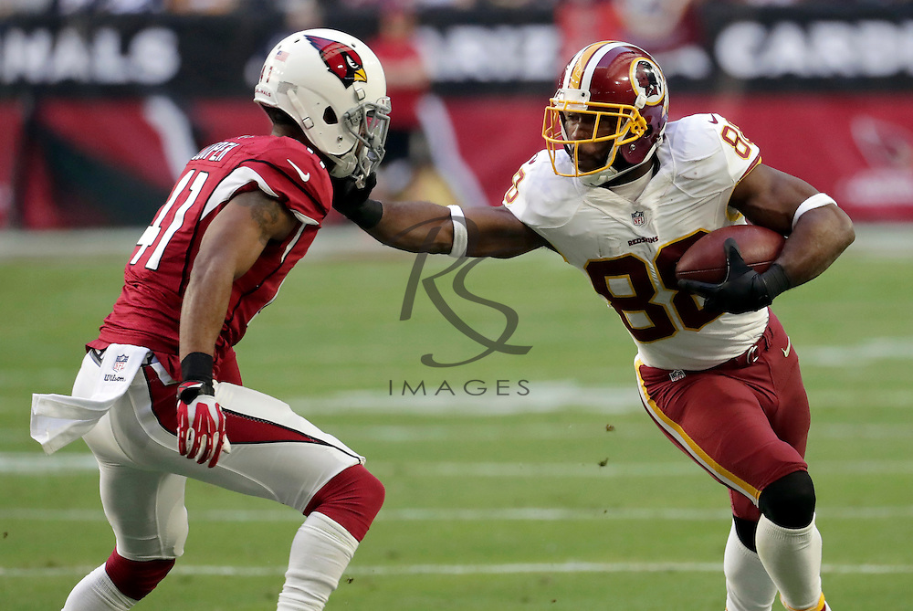 Washington Redskins wide receiver Pierre Garcon (88) stiff arms Arizona Cardinals cornerback Marcus Cooper (41) during the first half of an NFL football game, Sunday, Dec. 4, 2016, in Glendale, Ariz. (AP Photo/Rick Scuteri)