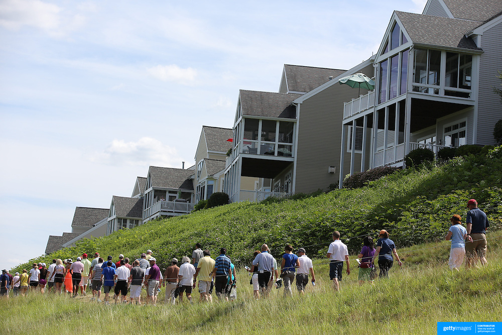Spectators walk past the golf course housing overlooking the 14th fairway during the second round of the Travelers Championship at the TPC River Highlands, Cromwell, Connecticut, USA. 20th June 2014. Photo Tim Clayton