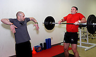 Owner Jason Hoskins of Dayton (left) and Aaron Pertner of Dayton during a workout of the day session at Vigor Crossfit in Moraine, Wednesday, January 25, 2012.