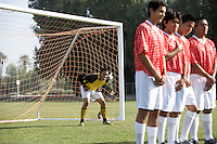Soccer players preparing for free kick