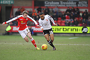 James Jones battles for the ball from Louis Thompson during the match at the Sky Bet League 1 match between Crewe Alexandra and Swindon Town at Alexandra Stadium, Crewe, England on 28 February 2015. Photo by Andrew Morfett.