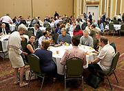 Faculty members having conversation at President Nellis's first Breakfast for Progress.