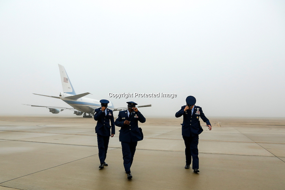 U.S. President Barack Obama departs aboard Air Force One in foggy conditions for travel to Atlanta from Joint Base Andrews.