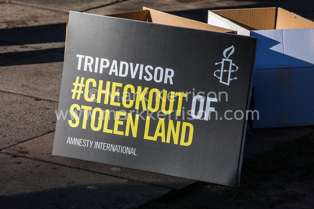 London, UK. 30th January, 2019. A placard used by campaigners from Amnesty International UK for a 'barbed wire beach' outside the headquarters of TripAdvisor as part of a campaign to highlight the fact that the online tourism company arranges holidays in illegal Israeli settlements in the Israeli-occupied Palestinian Territories.