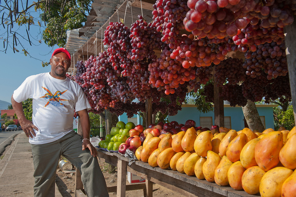 Fruit stall with vendor,Jarabacoa,La Vega Dominican Republic, Caribbean