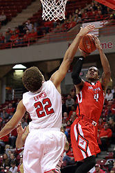 29 November 2014:  Reggie Lynch rejects a shot by Shawn Amiker during an NCAA men's basketball game between the Youngstown State Penguins and the Illinois State Redbirds  in Redbird Arena, Normal IL.