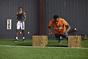 Adrian Ramirez works out with Quincy and Kennedy Monday in Kennedale, Texas on April 14, 2016. (Cooper Neill)