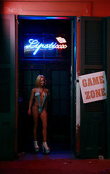 03 Feb 2013. New Orleans, Louisiana USA. .Bourbon Street strip Club. A dancer stands in the doorway of Lipstix Gentlemen's club in the heart of the French Quarter..Photo; Charlie Varley