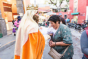 The Three Kings carry a baby Jesus doll to be blessed by the gathered crowd during El Dia de Reyes January 6, 2016 in San Miguel de Allende, Mexico. The traditional festival marks the culmination of the twelve days of Christmas and commemorates the three wise men who traveled from afar, bearing gifts for the infant baby Jesus.