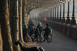 London, February 24th 2016. Schoolchildren on Cheyne Walk in Chelsea as the sun rises on a chilly but clear London morning. ///FOR LICENCING CONTACT: paul@pauldaveycreative.co.uk TEL:+44 (0) 7966 016 296 or +44 (0) 20 8969 6875. ©2015 Paul R Davey. All rights reserved.