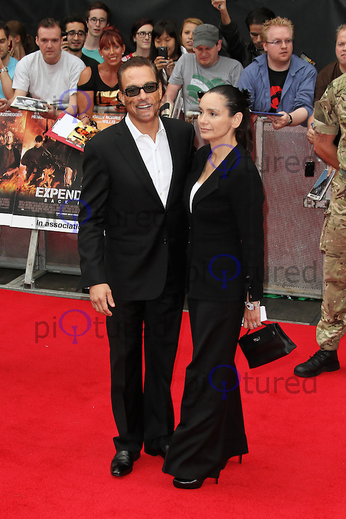 LONDON - AUGUST 13: Jean-Claude Van Damme; Gladys Portugues attended the UK Film Premiere of 'The Expendables 2', Leicester Square, London, UK. August 13, 2012. (Photo by Richard Goldschmidt)