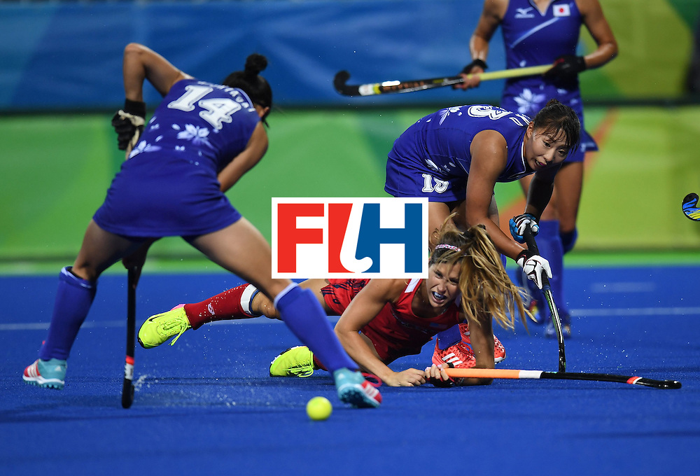 The USA's Katie Reinprecht (C) look on as Japan's Emi Nishikori (L) and Japan's Yukari Mano try to stop the ball during the women's field hockey USA vs Japan match of the Rio 2016 Olympics Games at the Olympic Hockey Centre in Rio de Janeiro on August, 10 2016. / AFP / MANAN VATSYAYANA        (Photo credit should read MANAN VATSYAYANA/AFP/Getty Images)