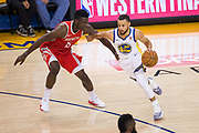 Golden State Warriors guard Stephen Curry (30) drives to the basket against the Houston Rockets during Game 3 of the Western Conference Finals at Oracle Arena in Oakland, Calif., on May 20, 2018. (Stan Olszewski/Special to S.F. Examiner)