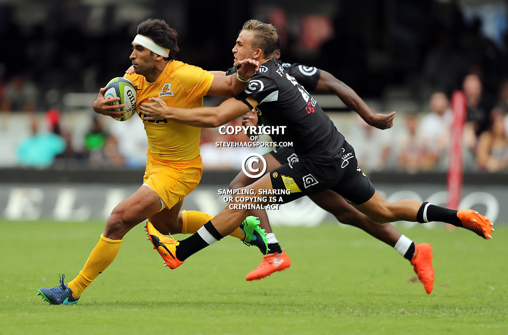 Matias Orlando of the Jaguares is tackled by Jeremy Ward of the Cell C Sharks during the Super Rugby match between the Cell C Sharks and the Jaguares  April 8th 2017 - at Growthpoint Kings Park,Durban South Africa Photo by (Steve Haag)