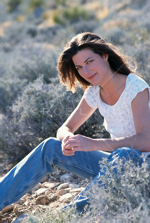 woman sitting in the Las Vegas, NV desert