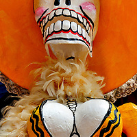 Day of the Dead Figurine with Feather Boa in Cabo San Lucas, Mexico<br /> This damsel wearing a wide brim hat and feather boa caught my eye.  She is a Day of the Dead figurine.  They are used on November 1 and 2 during a Mexican holiday called Dia de los Muertos. The celebration honors deceased family members.  Some believe these skeletal statues provide good luck.  I believe it is a portrait of a college girl leaving a night club after last call.