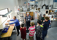 WARMINSTER, PA -  OCTOBER 4: Kevin Danielson (left) and Greg Throop (center) speak to students from Upper Moreland High School at MK Precision October 4, 2013 in Warminster, Pennsylvania.  Warminster's MK Precision participated in National Manufacturing Day, a nationwide event in which local manufacturers host open houses at their facilities to raise awareness that American manufacturing is far from dead. (Photo by William Thomas Cain/Cain Images)
