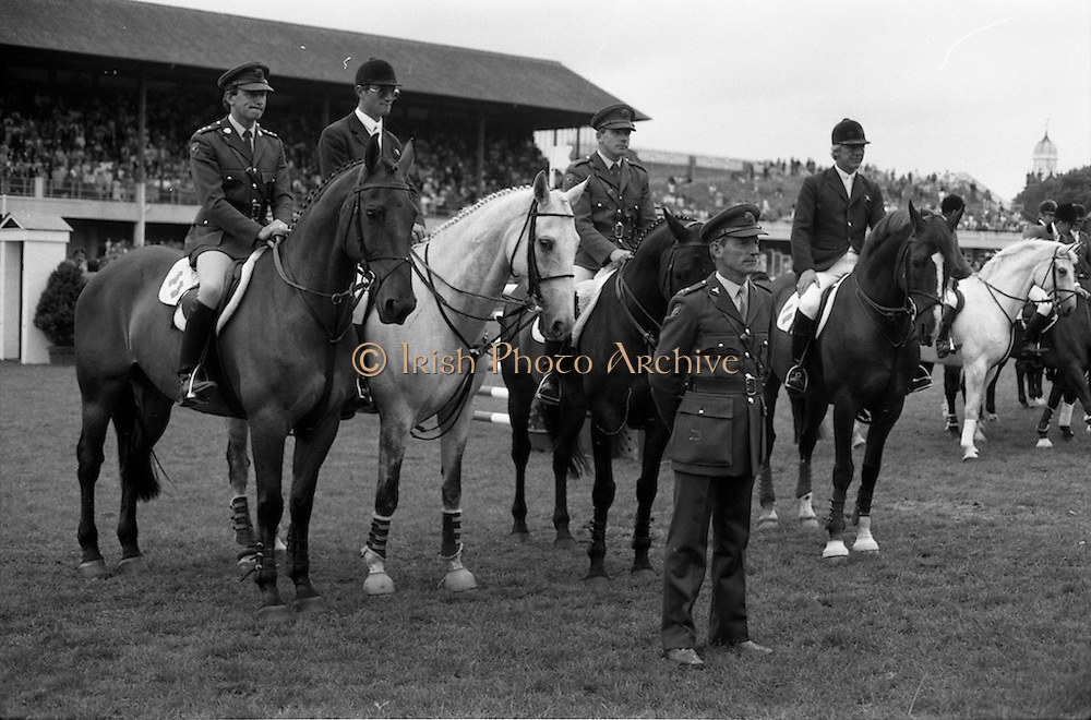 "07/08/1987<br /> 08/07/1987<br /> 07 August 1987<br /> Bank of Irelands Nations Cup for the Aga Khan trophy competition at the Dublin Horse Show at the RDS, Dublin. The winning Irish team  after their victory. Pictured (l-r):  Captain John Ledingham on ""Gabhran""; Jack Doyle on ""Hardly""; Commandant Gerry Mullins on ""Limerick"" and Eddie Macken on ""Carroll's Flight"". In front is Col. Ned Campion, Chef d'Equipe ."