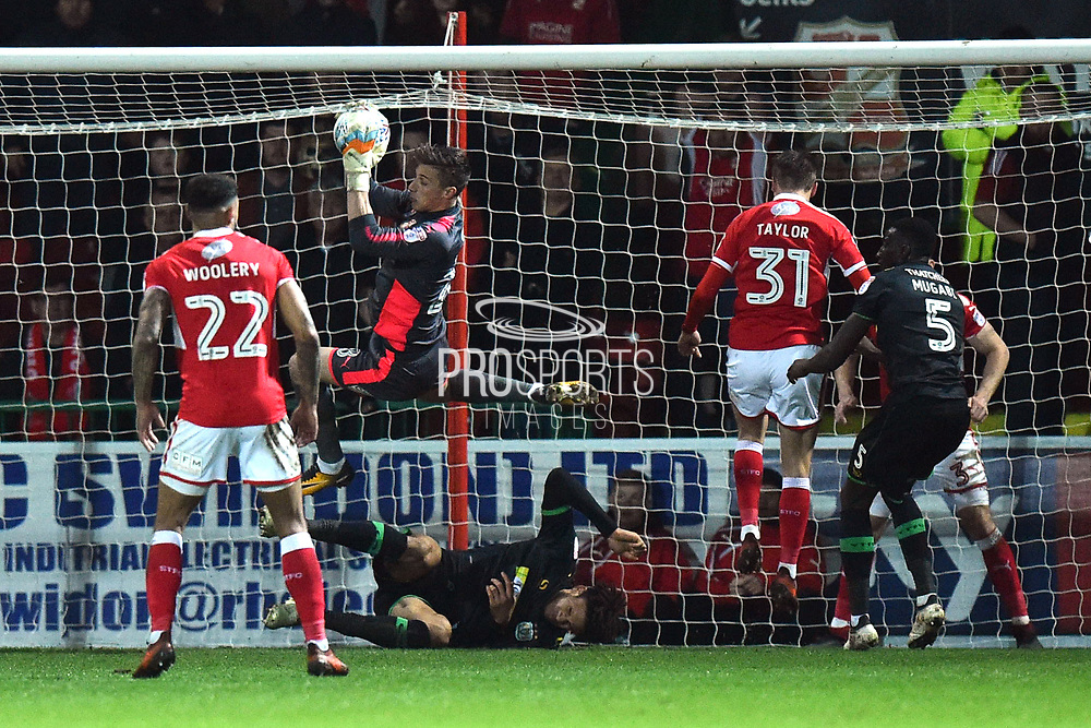 Stuart Moore (28) of Swindon Town leaps up to claim the ball during the EFL Sky Bet League 2 match between Swindon Town and Yeovil Town at the County Ground, Swindon, England on 10 April 2018. Picture by Graham Hunt.