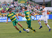 Tampa Bay Rowdies forward Juan Tejada(17) and forward Sebastian Guenzatti(13) take the ball from Swope Park Rangers midfielder Rassanbek Akhmatov(95) battle for the ball during a USL soccer game, Sunday, May 26, 2019, in St. Petersburg, Fla. The Rowdies defeated the Rangers 1-0. (Brian Villanueva/Image of Sport)