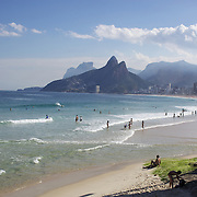 A beach scene looking along the stretch of beaches including Arpoador, Ipanema and Leblon beaches, from Pedra do Arpoador. Rio de Janeiro, Brazil. 3rd July 2010. Photo Tim Clayton....