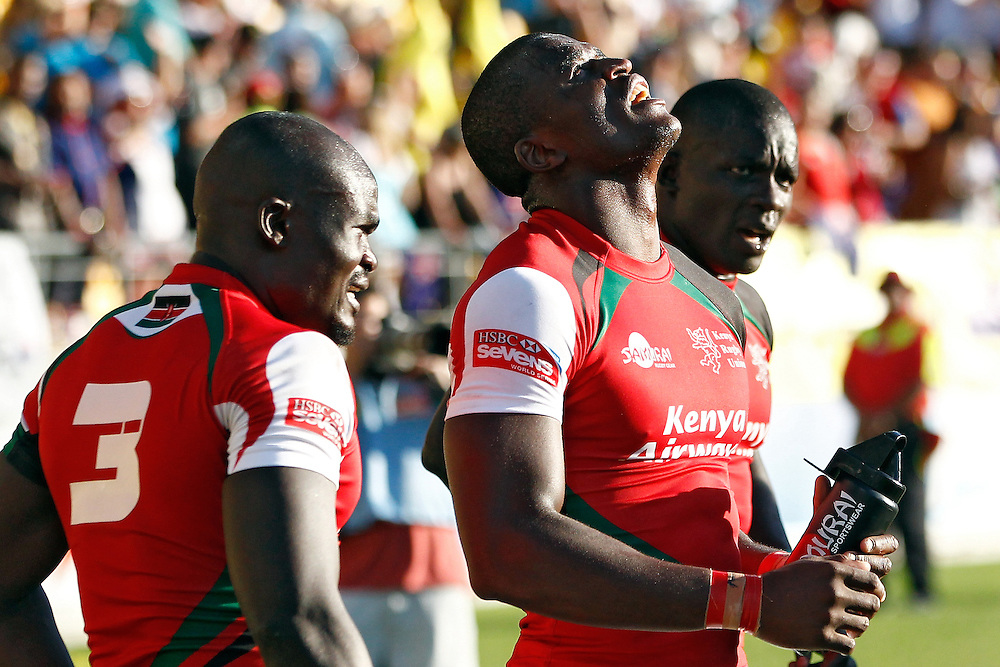 Kenya's Willy Ambaka, centre, looks skyward after beating New Zealand during the IRB International Rugby Sevens semi final at Westpac Stadium, Wellington, New Zealand, Saturday, February 02, 2013. Credit: Dean Pemberton.