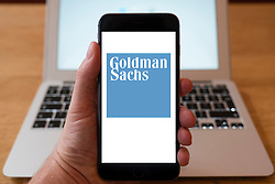 Using iPhone smartphone to display logo of Goldman Sachs the American multinational finance company