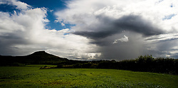 © Licensed to London News Pictures. 28/07/2012..Roseberry Topping, England..Storm clouds approach Roseberry Topping which is a distinctive hill on the border between North Yorkshire and the borough of Redcar and Cleveland, England. It is situated near the small village of Great Ayton..Photo credit : Ian Forsyth/LNP