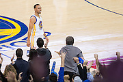 Golden State Warriors guard Stephen Curry (30) celebrates after hitting a three pointer against the LA Clippers at Oracle Arena in Oakland, Calif., on February 23, 2017. (Stan Olszewski/Special to S.F. Examiner)at Oracle Arena in Oakland, Calif., on February 23, 2017. (Stan Olszewski/Special to S.F. Examiner)