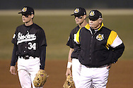 Wichita State head coach Gene Stephenson (R) stands with Shocker shortstop Noah Krol (C) and third basemen Conor Gillaspie (L), during a pitching change against Kansas State.  K-State defeated the 19th ranked Shockers 6-3 at Tointon Stadium in Manhattan, Kansas, March 14, 2006.