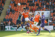 John Marquis of Portsmouth attacks a free kick during the EFL Sky Bet League 1 match between Blackpool and Portsmouth at Bloomfield Road, Blackpool, England on 31 August 2019.