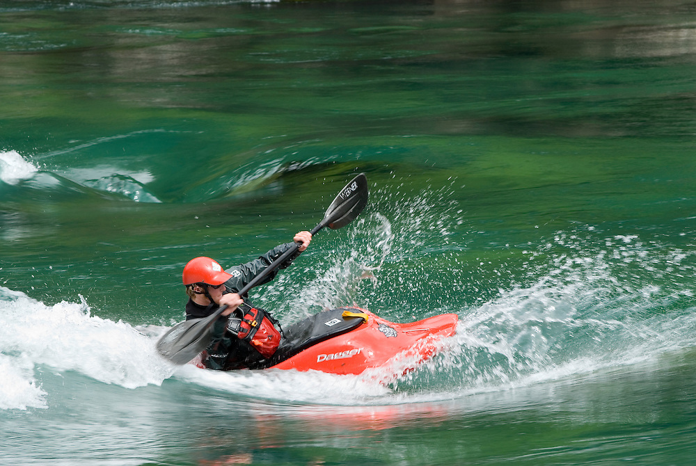 Kayaker surfing a wave on Chile's Futaleufu River.
