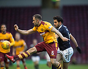 23rd December 2017, Fir Park, Motherwell, Dundee; Scottish Premier League football, Motherwell versus Dundee; Motherwell's Peter Hartley clears from Dundee's Sofien Moussa