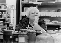 Picture by Mark Larner. Picture shows an old lady running the jam stall at the Oxshott Women's Institute Christmas Fair at the village hall. 1994