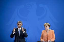 59860283    <br /> Barack Obama, president of the USA, and German Chancellor Angela Merkel (right) during a press call at a state visit of the Chancellery in Berlin, Germany. Barack Obama will walk in John F. Kennedy's footsteps this week on his first visit to Berlin as US president, but encounter a more powerful and sceptical Germany in talks on trade and secret surveillance practices. International Politics, Berlin, Germany on Wednesday 19 June, 2013. UK ONLY
