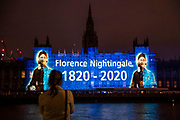 An image of Florence Nightingale and a contemporary nurse is projected onto the Houses of Parliament opposite St Thomas' Hospital (where she worked) as it is both International Nurses Day an teh anniversary of her birth 200 years ago today. The message is also one of support for current day nurses as the 'lockdown' continues for the Coronavirus (Covid 19) outbreak in London.